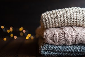 Stack of cozy knitted sweaters on