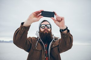 bearded hipster taking selfie