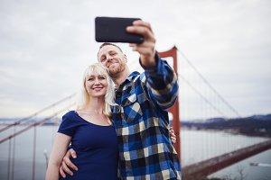 couple selfies by golden gate bridge