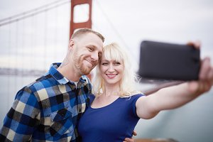 romantic couple posing for selfies