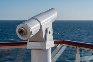 Optical telescope on deck of cruise