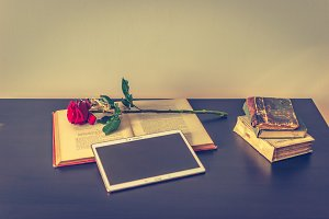 Books, tablet and rose 1