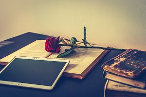 Books, tablet and rose 2