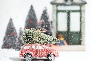 Red toy car with Christmas tree