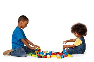 Little kids playing with blocks