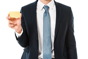 smiling businessman in suit holding