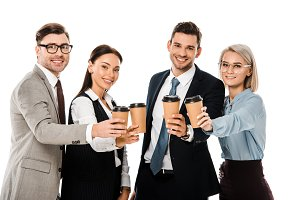businesspeople holding paper cups wi