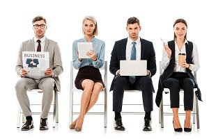 businesspeople sitting on chairs wit