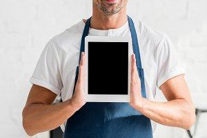 adult man holding digital tablet wit