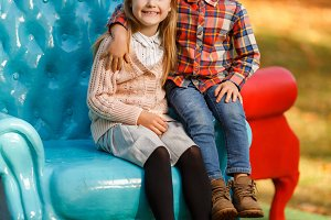 Picture of girl and boy sitting on