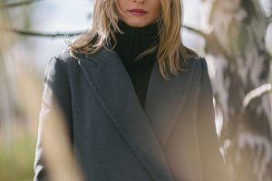 Photo of young woman in gray coat on