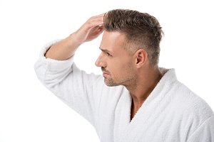 side view of upset adult man in bath