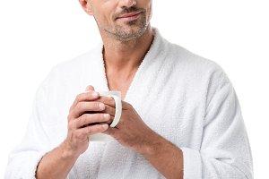 happy adult man in bathrobe holding