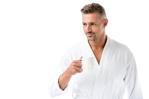 cheerful man in bathrobe holding cof