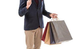 cheerful stylish man with shopping b