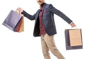 smiling adult male shoppper in jacke