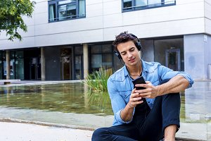 Man sitting listening music Headphon