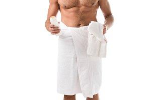 joyful muscular shirtless man wrappe