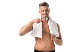 smiling adult man with toothbrush lo
