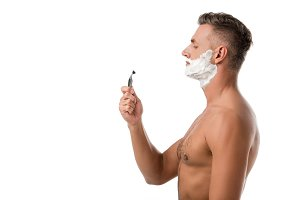 side view of adult man with shaving