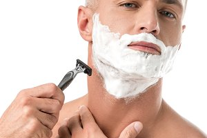 confident man with foam on face shav