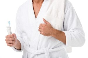 cropped image of man in bathrobe wit