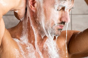 adult man with closed eyes washing f