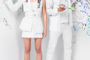 fashion shoot of couple in total whi