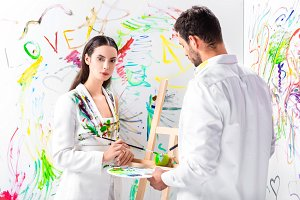 adult couple in total white painting