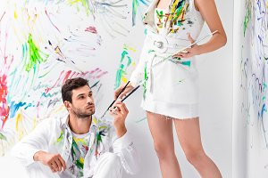 couple in painted white clothes with