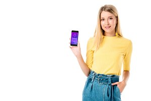beautiful young woman holding smartp