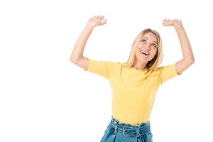 cheerful young woman raising hands a