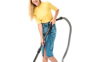 beautiful young woman using vacuum c