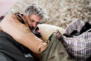 Homeless beggar man lying outdoors