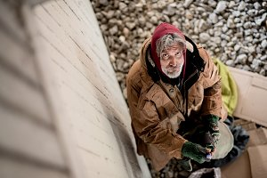 A top view of homeless beggar man