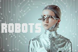 futuristic silver cyborg looking awa