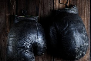 very old black boxing gloves