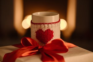 present and knitted mug with heart s