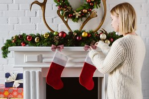 young woman decorating fireplace wit