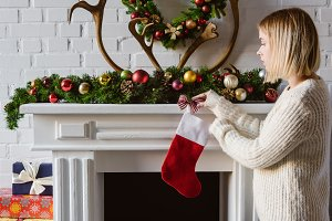young woman in sweater decorating fi