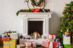 festive decorations over fireplace w