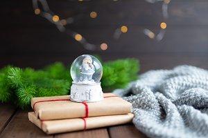 Magic snow ball with santa standing