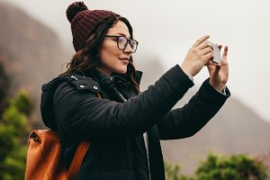 Female tourist capturing