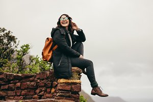 Female hiker relaxing at the hill