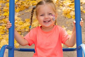 Girl swinging on swing and smiling