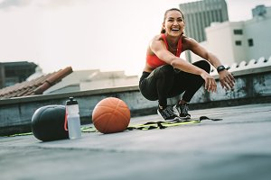 Smiling fitness woman doing sit ups