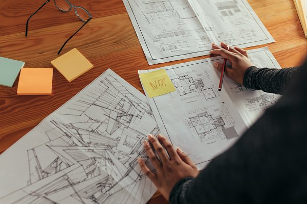 Designer working on building