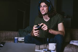 Man playing video game at home