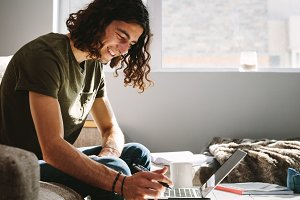 Smiling man studying at home