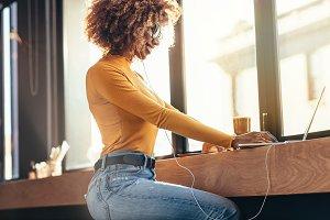 Freelancer woman working on laptop